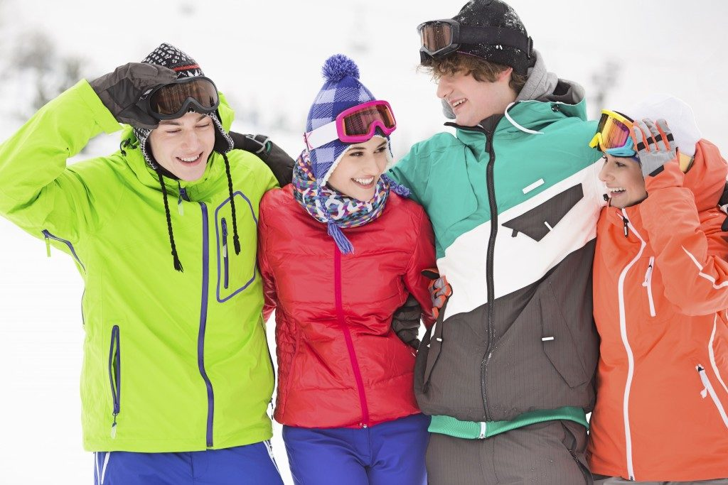 group of friends in their ski suits