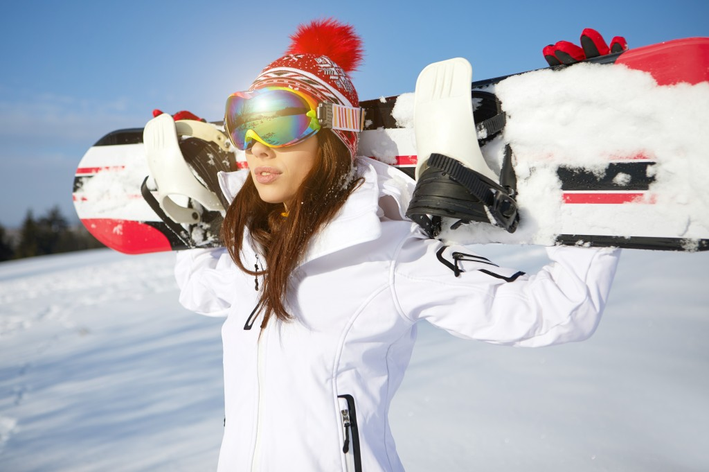 woman wearing a white ski suit and googles