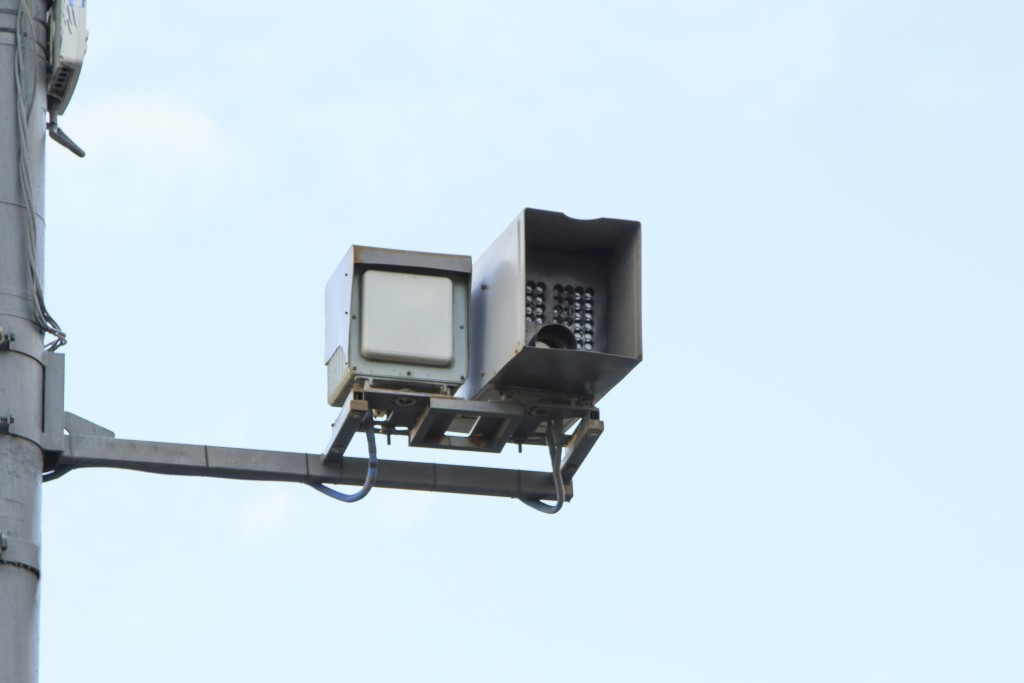 Radar gun attached on a pole to get speed of passing cars